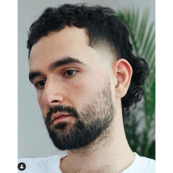 Tight Fade With Mullet Haircut