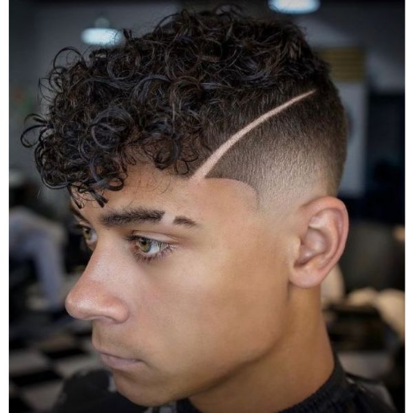 High Fade With Side Razor Design And Curly Top