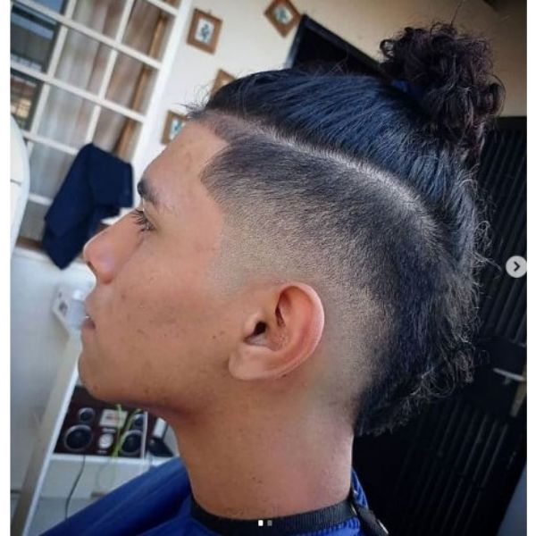 Blurry High Fade With Curly Man Bun Hairstyle
