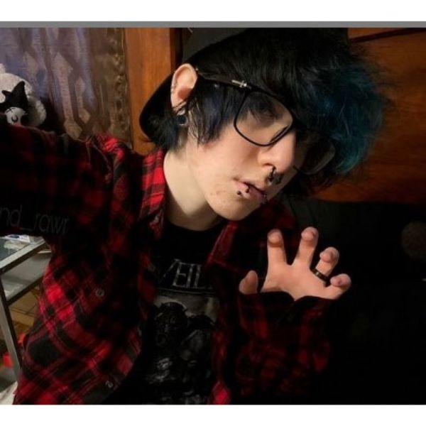 Dark Short Emo Hairstyle For Guys With Blue Fringe