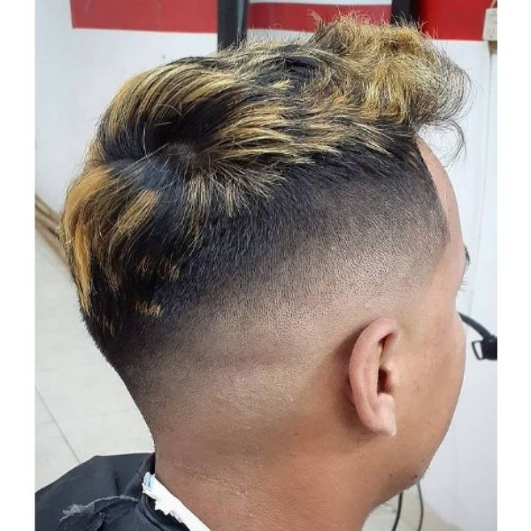 High Fade With Blonde Highlights And Messy Top
