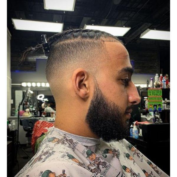 High Fade With Box Braids And Beard
