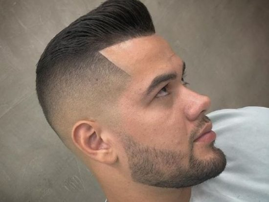 High Fade With Small Pomp Hairstyle