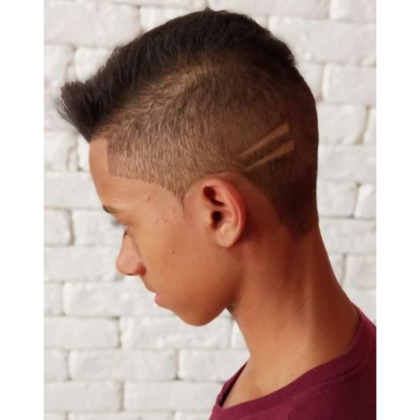 High Fade With Spiky Top And Small Razor Design