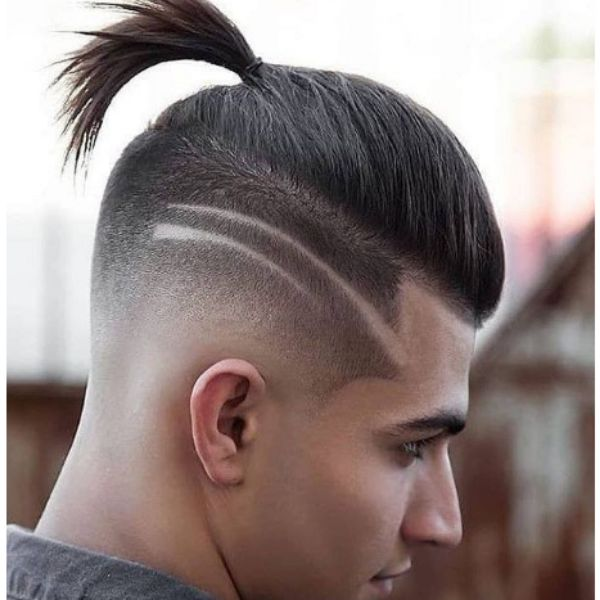 High Fade With Top Knot And Side Razor Design