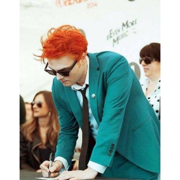 Short Upswept Orange Hairstyle For Guys