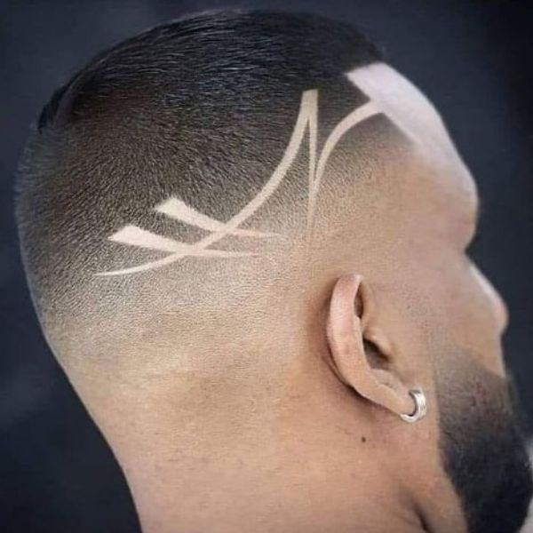 Stylish High fade haircuts for men With Artistic Razor Pattern