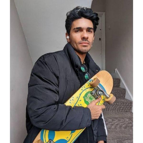 Dark Short Chopped Skater Hairstyles For Men