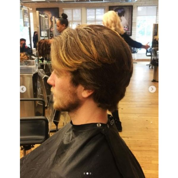 Medium Long Feathered Skater Hairstyles For Men With Thin Brown Lights