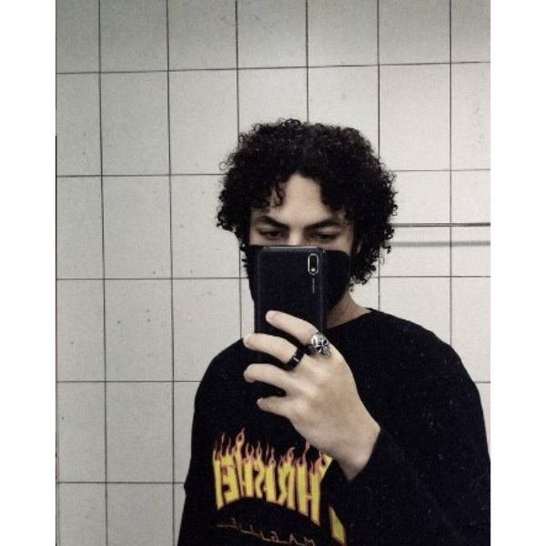 Grunge Curly Medium Skater Hairstyle For Men