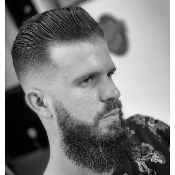 High Fade With Long Trimmed Top And Widow Peak