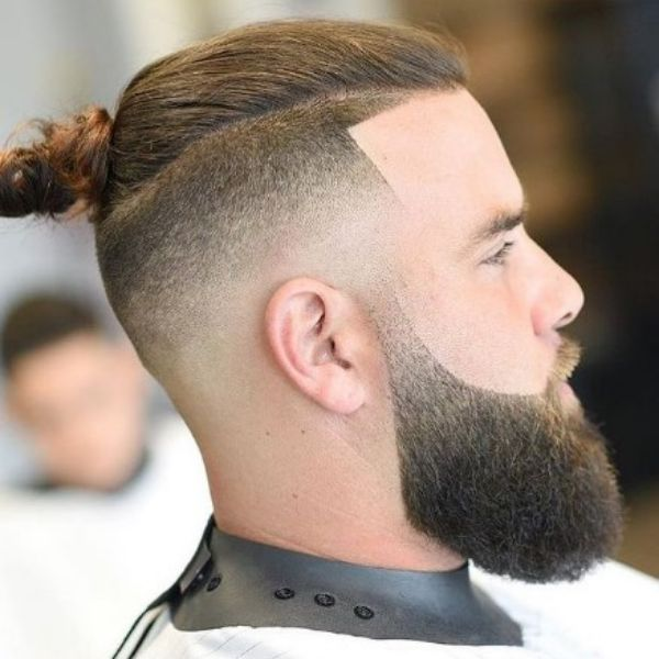 High Fade With Top Knot And Clean Beard