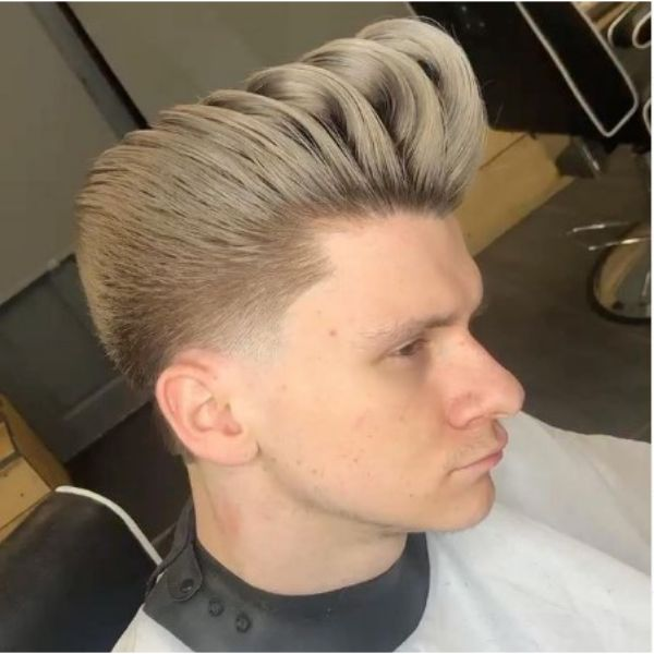 High Undone Pompadour With Cold Blonde Shade And Widows Peak Hairstyles