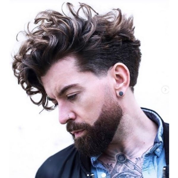 Messy Pompadour With Shaved Sides And Brown Highlights