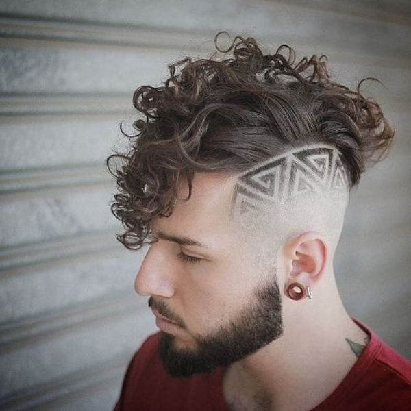Sharp Fade With Side Design And Widows Peak Hairstyles