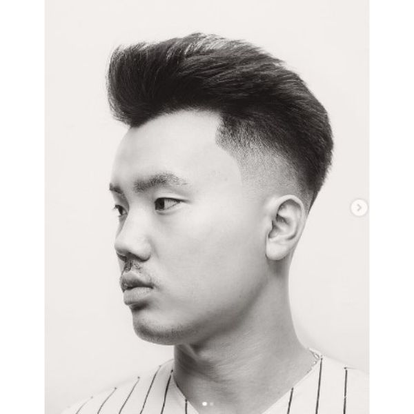 Simple Mid Fade With Widows Peak Hairstyles And Spiky Top