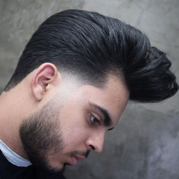 Sleek Dark Pompadour Haircut With Widows Peak Hairstyles