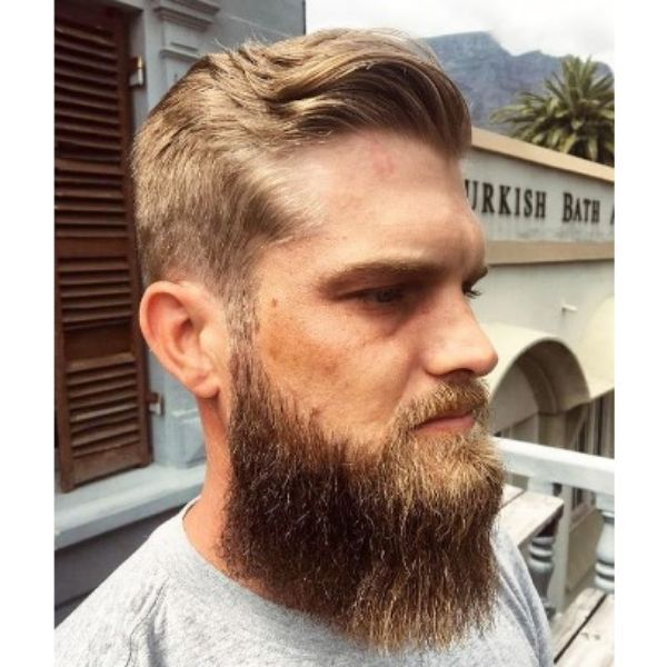 Wavy Flowy Blonde Haircut With Long Beard