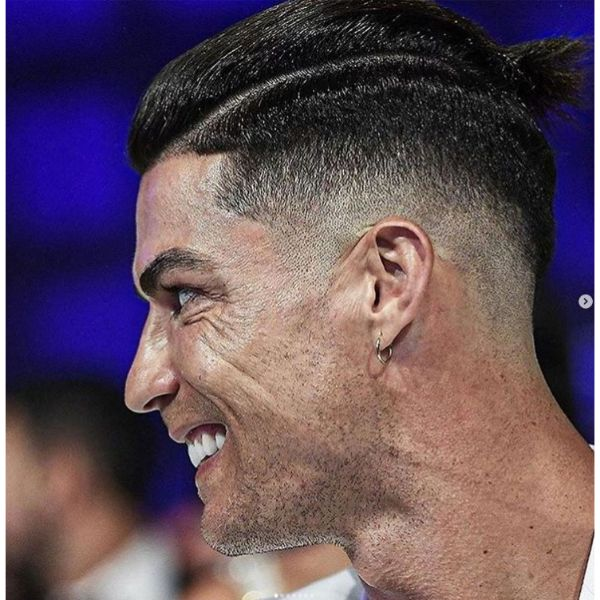 Mid Fade With Top Knot And Hard Side Part